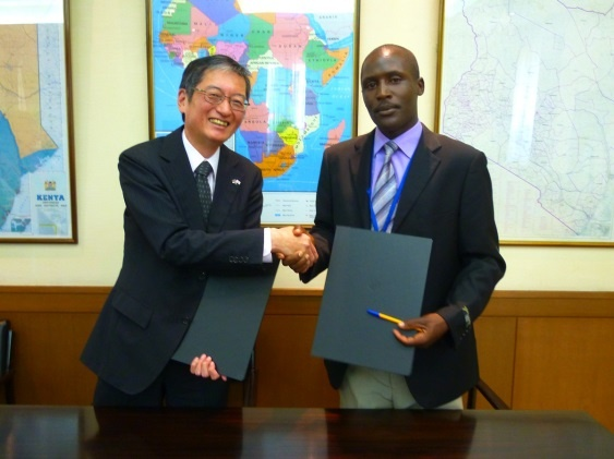 Grant contract signing between H.E.  Mr Terada, Ambassador of Japan to the Republic of Kenya and Mr. Limo Symon  Peter, Chairperson of Oasis Logistics Youth Group