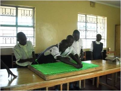 Children with mental disabilities learning weaving in the newly constructed classrooms