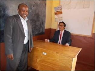 Observation of the classrooms: Mr. Mori with the School Chairperson, Mr. Godfrey M. Rumo