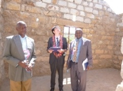 Mr. Yamana touring the current school facilities with Head Teacher and Chairman