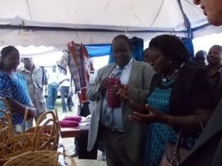Governor Cyprian Awiti viewing the products made by women at the Empowerment Centre