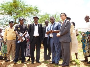 Mr Mikio Mori, Mr Vonza Mwendwa, Chairman of  WGDP, Mr Sammy Ngangi, CEO of  WGDP touring the site with the community