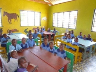 Newly built ECD classrooms and happy pupils.