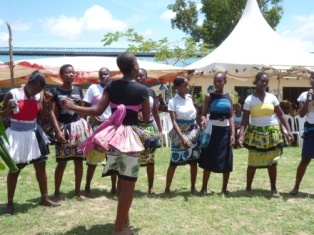 Secondary school girls singing and dancing.