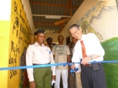 Ambassador Terada cutting the ribbon to open the new school facility.