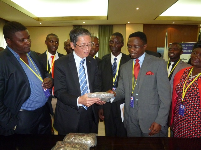 Hon. Ababu Namwamba explaining to Ambassador Terada about Omena fish from Lake Victoria.