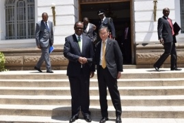 H.E. Mr. Tatsushi Terada and H.E. Dr. Evans Kidero shaking hands in front of the Nairobi City Hall