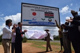 H.E. Mr. Tatsushi Terada and Mrs. Martha Mulwa unveiling the signboard