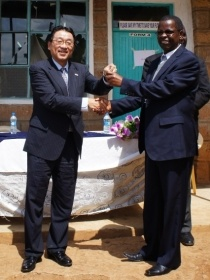 Minister Mori handing over the keys to the new boys' dormitory to Mr. Kariuki (Chairman of St. Lucy B.O.M.)
