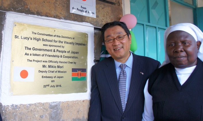 Minister Mori and Sister Olang' unveiling plaque to commemorate the occasion